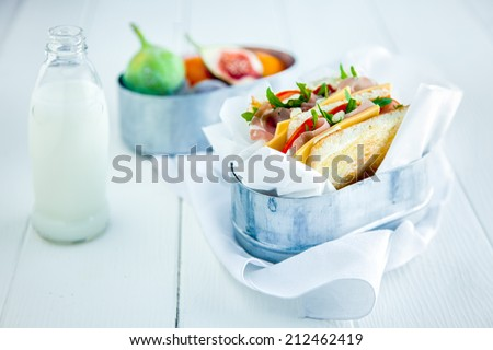 Tasty Sandwich with Fresh Milk and Fruits Served on White Wooden Table. Healthy Food for Day to Day. - stock photo