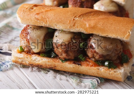 Tasty sandwich with meatballs and sauce close-up on the table. horizontal - stock photo