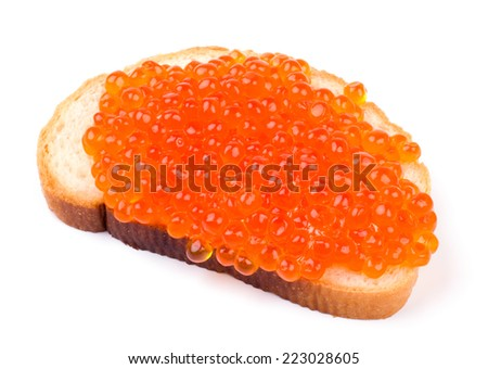 Tasty sandwich with red caviar isolated on white background cutout - stock photo