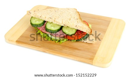 Tasty sandwich with salami sausage and vegetables on cutting board, isolated on white