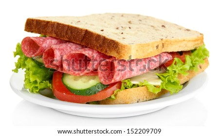 Tasty sandwich with salami sausage and vegetables on white plate, isolated on white - stock photo
