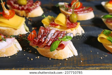 Tasty sandwiches on wooden table, close up - stock photo