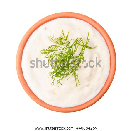 Tasty sauce with garlic and cucumber isolated on white. Top view. - stock photo