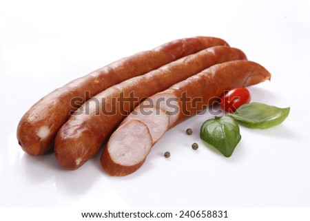 Tasty sausage with spices on white background - stock photo