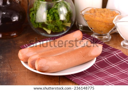 tasty sausages with parsley - stock photo