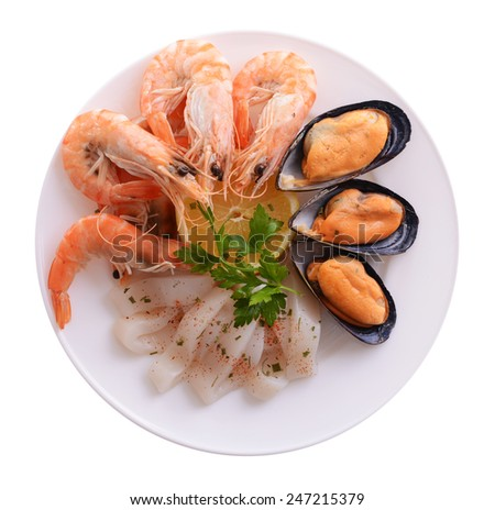 Tasty seafood on plate isolated on white - stock photo