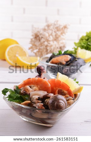 Tasty seafood on plate on table on light background - stock photo