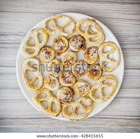 Tasty sesame pastries on the round plate. Food theme. Sesame snacks. Refreshments theme. - stock photo