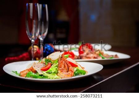 Tasty shrimp salad with vegetables - stock photo