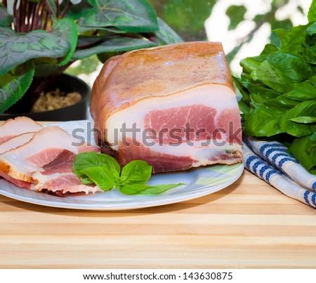 Tasty slices of Italian speck - stock photo