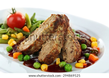 Tasty slices of meat with vegetables on plate close up