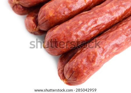 Tasty smoked beef sausages. Macro. Isolated on a white background.