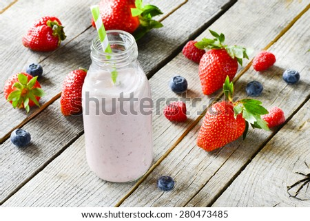 Tasty smoothie with fresh berries on a wooden table - stock photo