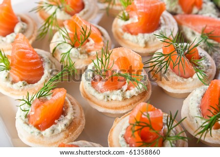 Tasty snacks with salted salmon and cottage cheese filling - stock photo