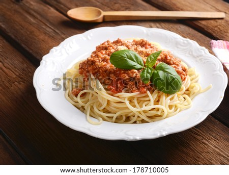 Tasty spaghetti with cheese and basil