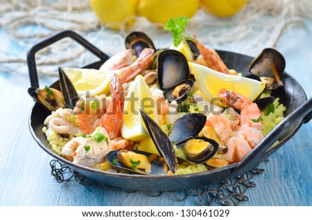 Tasty Spanish paella with seafood and chicken breast - stock photo