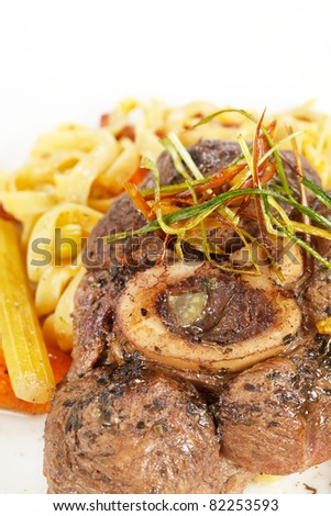 tasty steak with pasta
