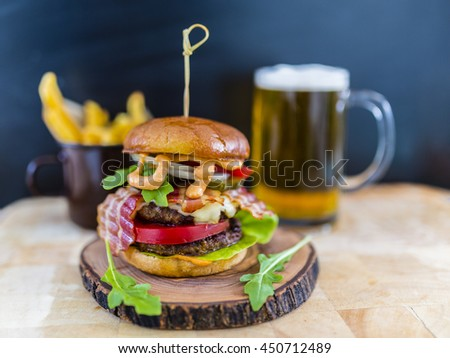 Tasty street food grilled double beef burger in crispy shortbread with lettuce and mayonnaise  - stock photo