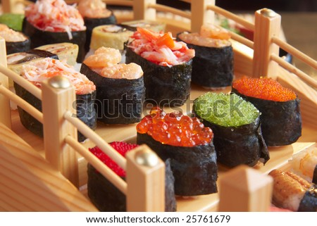 Tasty sushi prepared at japanese restaurant. - stock photo