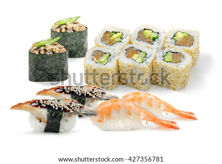 Tasty sushi set for lunch. Traditional Japanese food. Rolls with grilled salmon, cheese, snow crab, mussels and cucumber. - stock photo