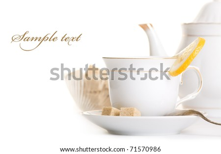 Tasty tea with lemon and sugar isolated over white - stock photo