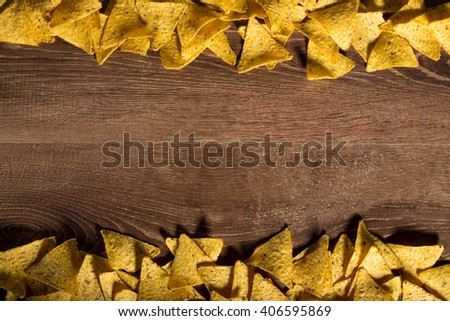 Tasty tortilla nachos background shot from above with the place for inscription - stock photo