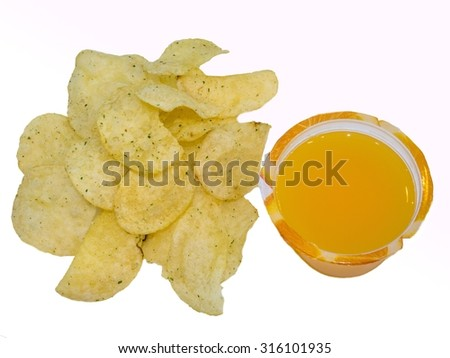 Tasty traditional potato chips snacks with orange juice. - stock photo