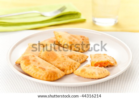 tasty tuna patty with tomato and pepper isolated