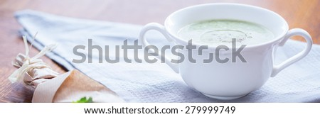Tasty vegetable cream soup with broccoli and olive oil - stock photo