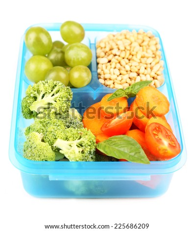 Tasty vegetarian food in plastic box, isolated on white - stock photo
