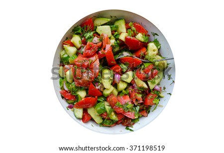 Tasty vegetarian salad with tomatoes and cucumber isolated on white