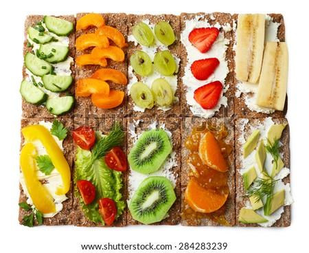 Tasty vegetarian sandwiches, isolated on white - stock photo