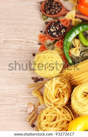 tasty vermicelli, spaghetti and vegetableson wooden background - stock photo