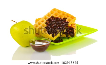 Tasty waffles with chocolate on plate isolated on white
