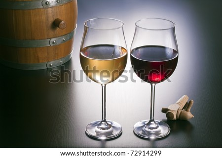 Tasty white wine and red wine, nicely furnished. - stock photo