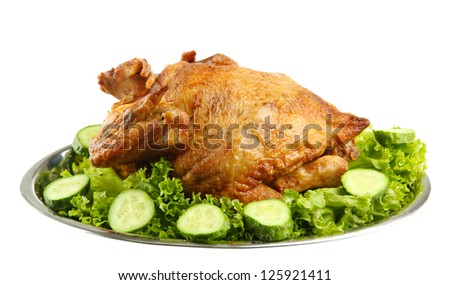 Tasty whole roasted chicken on plate with vegetables, isolated on white
