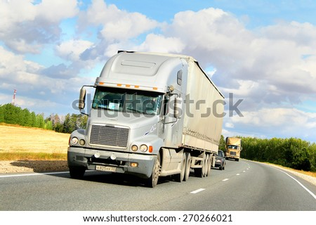 TATARSTAN, RUSSIA - AUGUST 27, 2011: American semi-trailer truck Freightliner Century Class at the interurban freeway. - stock photo