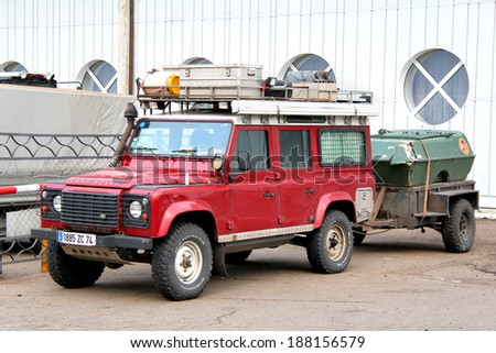 TATARSTAN, RUSSIA - AUGUST 20, 2011: Red Land Rover Defender off-road car at the camping. - stock photo