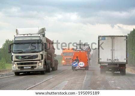 TATARSTAN, RUSSIA - MAY 29, 2013: Road works at the interurban freeway. - stock photo
