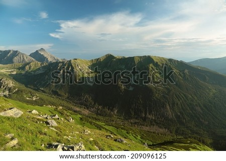 Tatra Mountains at dusk, view from the top of the Kasprowy wierch. - stock photo