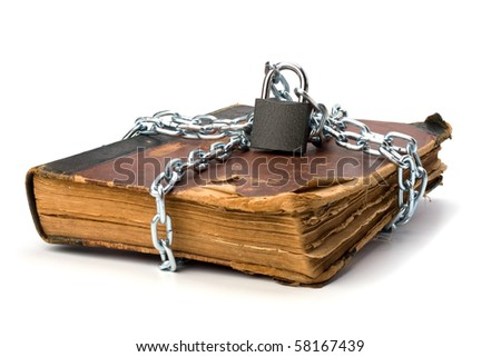 tattered book with chain and padlock isolated on white background - stock photo