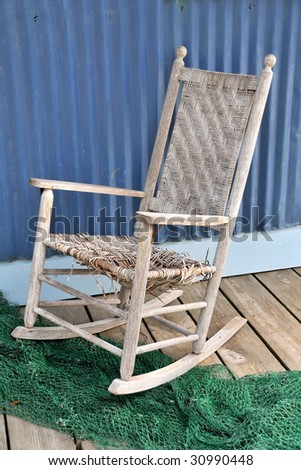 Tattered Old Seaside Rocking Chair Vertical - stock photo
