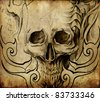 Tattoo art, sketch of skull with tribal designs - stock photo