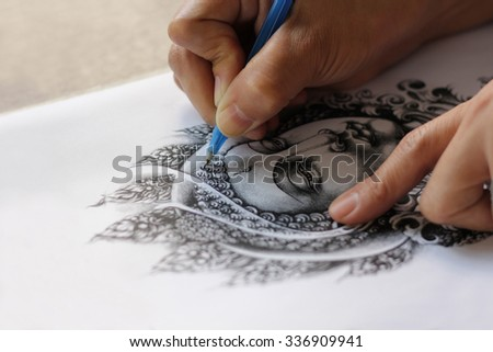 Tattoo designs are hand drawn image of Buddha. As for the tattoo. Belief and faith in Buddhism. Drawing on white paper. - stock photo
