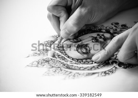 Tattoo designs are hand drawn image of Buddha black and white tone. As for the tattoo. Belief and faith in Buddhism. Drawing on white paper. - stock photo