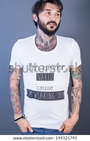tattoo man with funny t-shirt