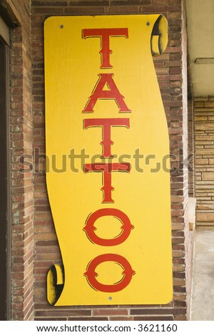 Tattoo sign outside of tattoo parlor. - stock photo
