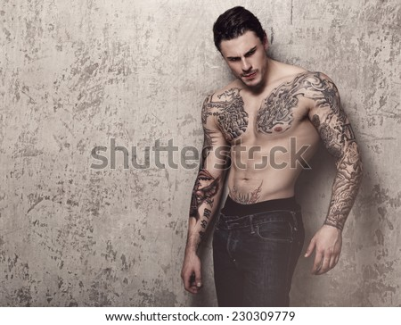 Tattooed guy with perfect body - stock photo