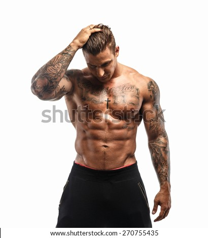 Tattooed muscular male on white background
