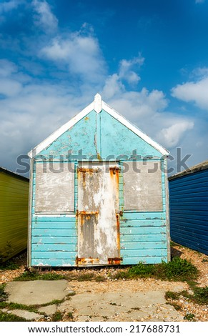 Tatty unloved old blue beach hut that's in need of TLC - stock photo
